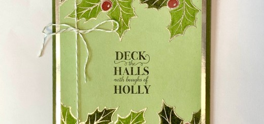 Holiday embossed monochrome holly card