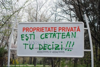 The sign states that the park is now private property. The voice of the people, in green: 'You Are a Citizen, You Decide'. The person who bought this side of the park, planns to take down all the trees, and buld a Mall. Another mall Bucharest doesn't need. And it's parking space. This is the World we are used to accept without questioning...