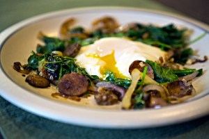 Poached egg with sausage and spinach