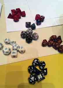 collections of colored multi-sided gamer dice