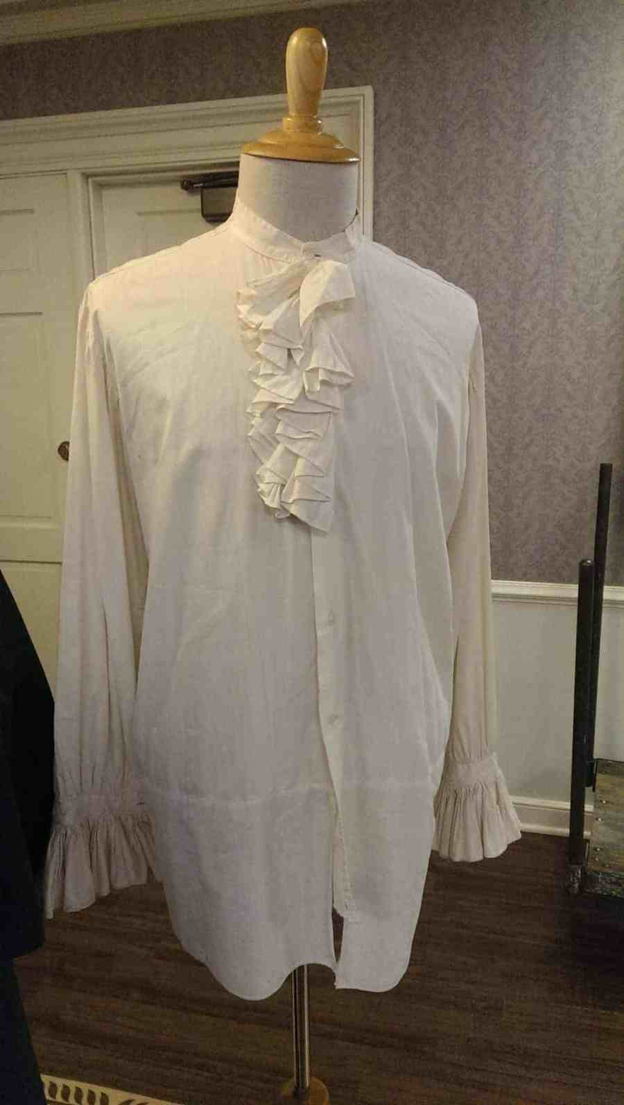 Shirt worn by Morton Lowry as Sir Hugo Baskerville in THE HOUND OF THE BASKERVILLES (1939). Long, loose cream shirt with ruffled collar.