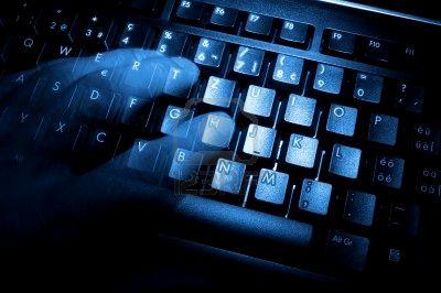 ghostly hands translucent over keyboard