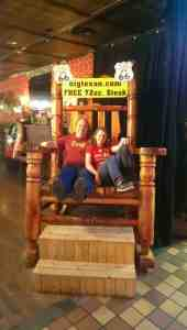 Jon and Laura sharing enormous rocking chair in the Big Texan