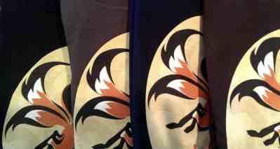 Kitsune-Tsuki logo shirts in black, smoke, navy, dark chocolate