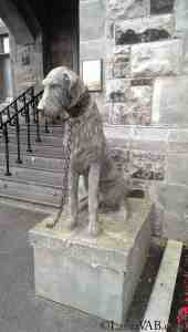 stone wolfhound chained at the front door