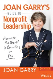 Photo of the cover of Joan Garry's Guide to Nonprofit Leadership featuring a color photo of Joan Garry, a white woman in a white top with a navy blue jacket. She has a beautiful smile.
