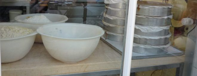 baking dishes in the window of a fancy bakery kitchen