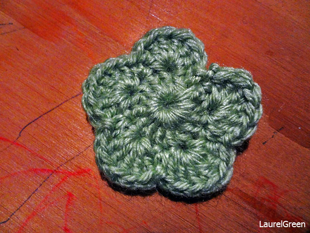 a photo of a green crocheted flower