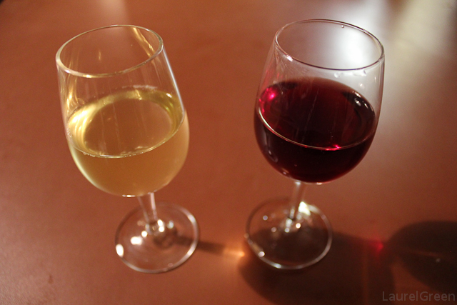 a photo of two wine glasses full of chardonnay and merlot