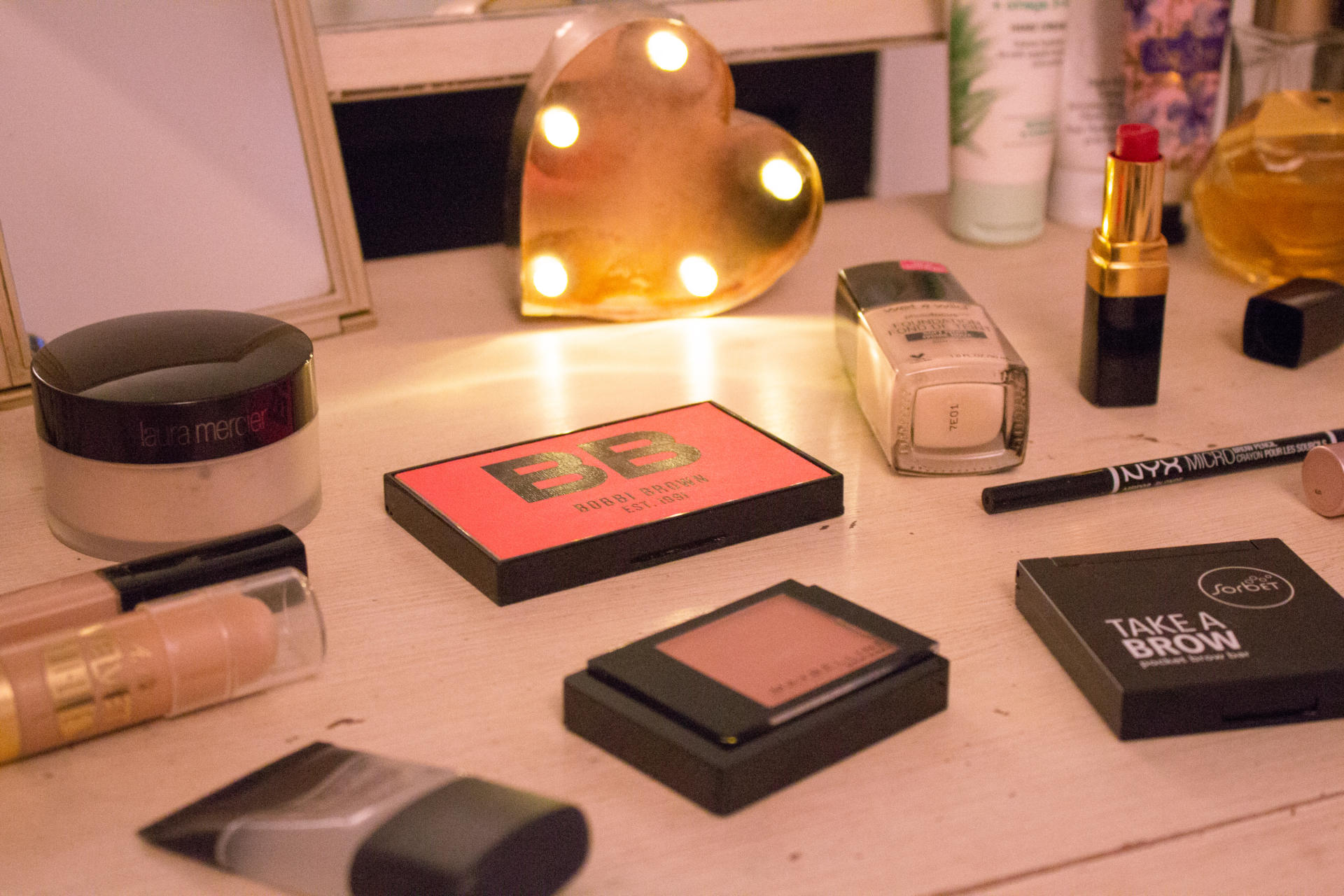 make-up products lying on dressing table