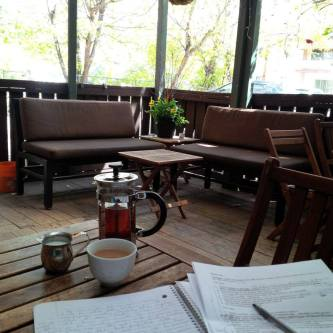 Writing, on the patio at Calgary's Oolong Tea House
