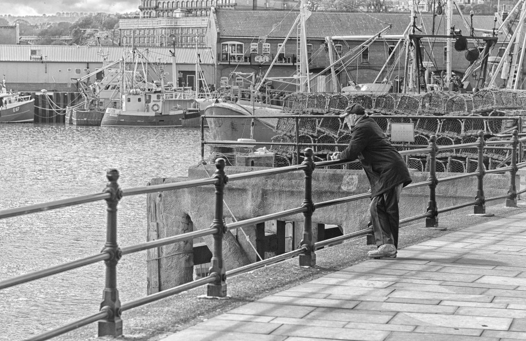 Man overlooking the harbour at Whitby