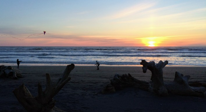 Flying a kite at sunset on the beach at Cape Disappointment
