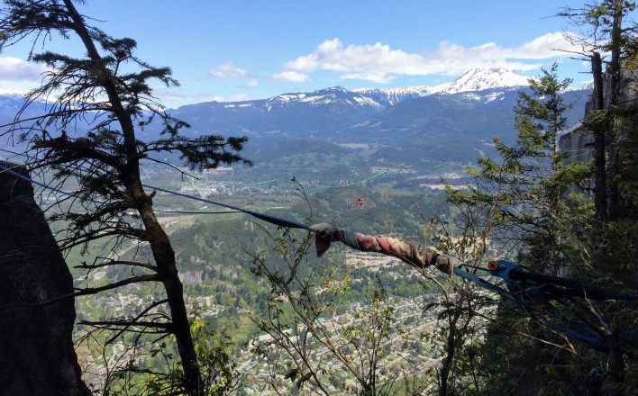 Tightroping across one of the Chief's deep clefts, rock climbers nab stunning views.
