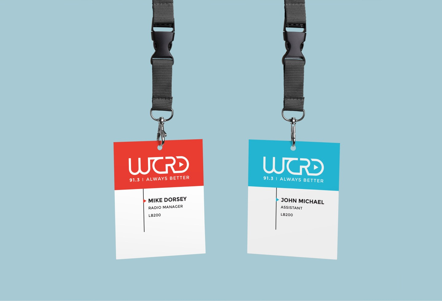 The WCRD primary logo lockup on a name badge in the two primary colors of blue and red