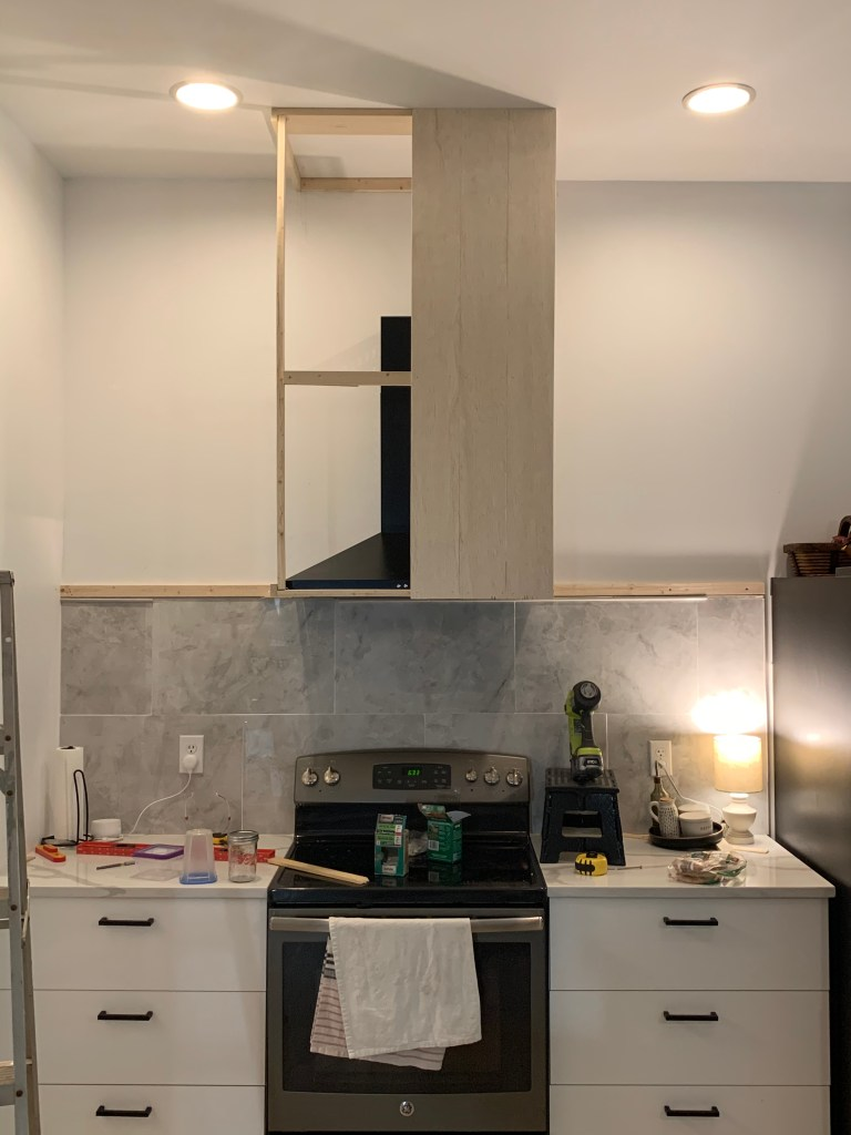 attaching vertical shiplap to diy vent hood cover