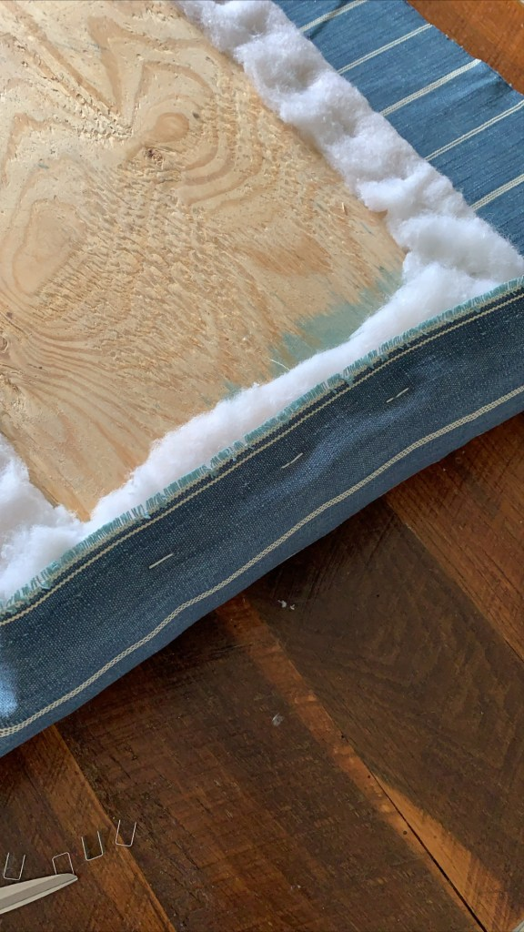 stapling fabric over batting and foam on upholstered bench seat cushion