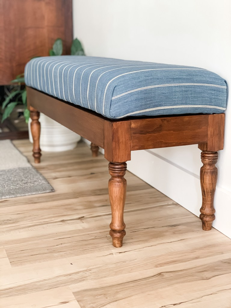 diy fabric storage bench with blue striped fabric and wood base