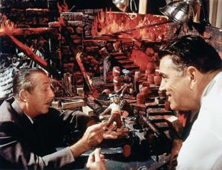 Walt Disney (left) checks out one of the figures and a model of one of the scenes of the Pirates of the Caribbean attraction for Disneyland with Disney Imagineer Claude Coats, who served as the production designer and art director for the ride. Coats also did the layouts for the routing of the boats through the buildings around and under New Orleans Square, then under the railroad tracks to the outer building. The attraction opened its doors on March 18, 1967. It was the last Disneyland attraction personally supervised by Disney, who died in December 1966. Photo taken circa early 1966 at Walt Disney Imagineering, then known as WED Enterprises. (Photo courtesy, The Disneyland Resort)