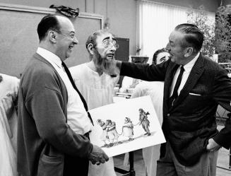 Walt Disney (right) checks out one of the Audio-Animatronics figures created for Pirates of the Caribbean at Disneyland based on a character design by Disney Imagineer Marc Davis (left). The attraction opened its doors on March 18, 1967. It was the last Disneyland attraction personally supervised by Disney, who died in December 1966. Photo taken circa early 1966 at Walt Disney Imagineering, then known as WED Enterprises. (Photo courtesy, The Disneyland Resort)