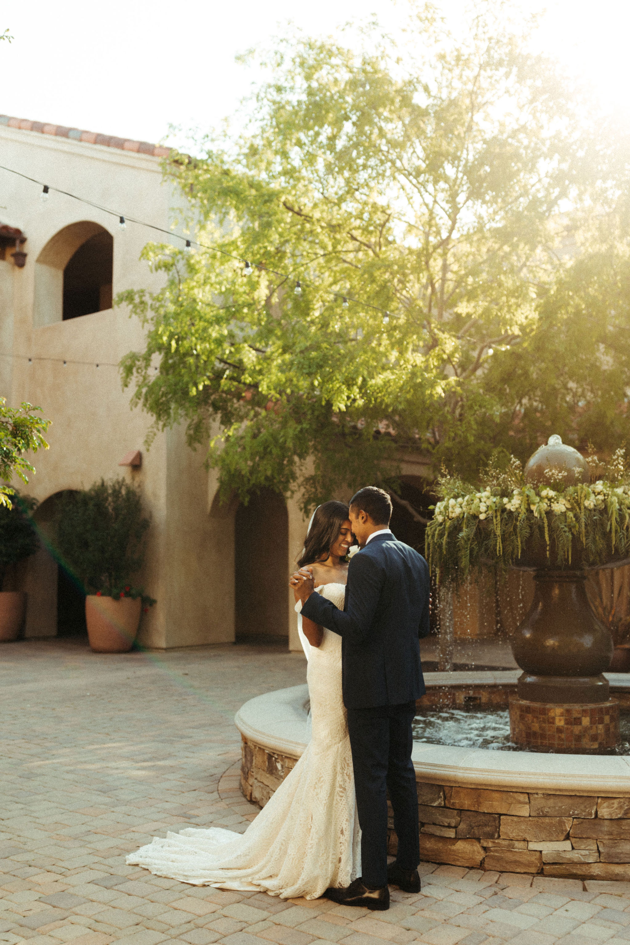 spanish style courtyard wedding venue with fountain