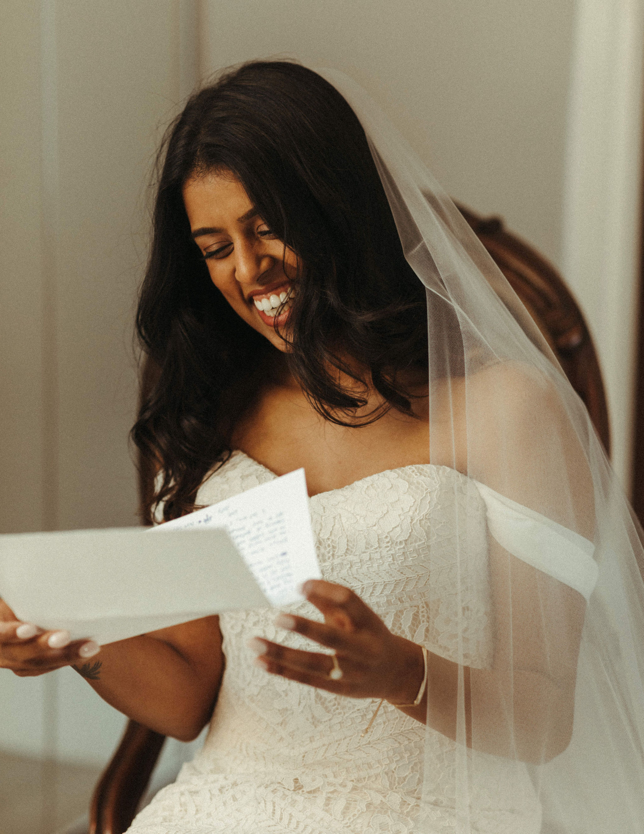 bride reading letter from groom before ceremony