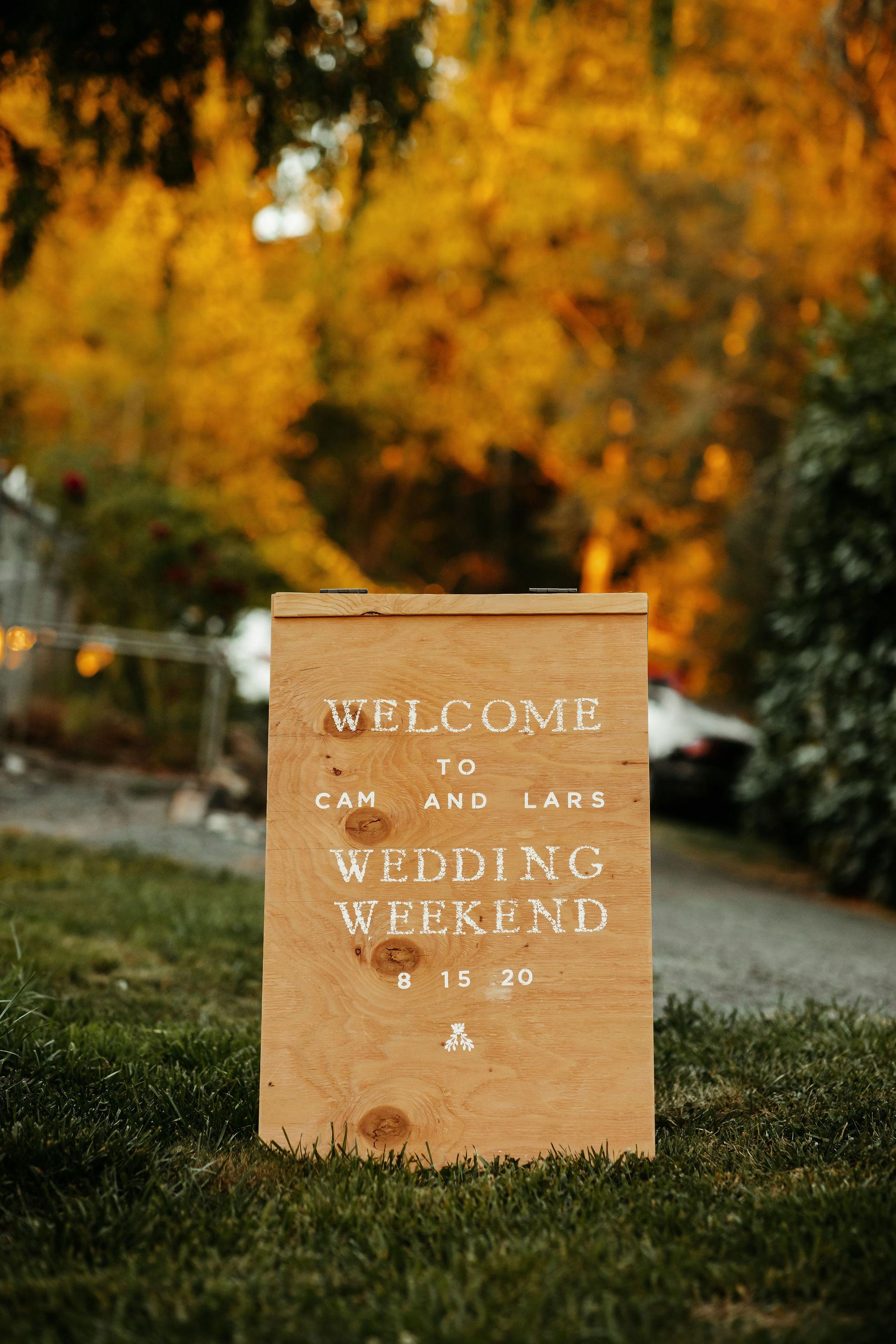 backyard pacific northwest wedding weekend sign