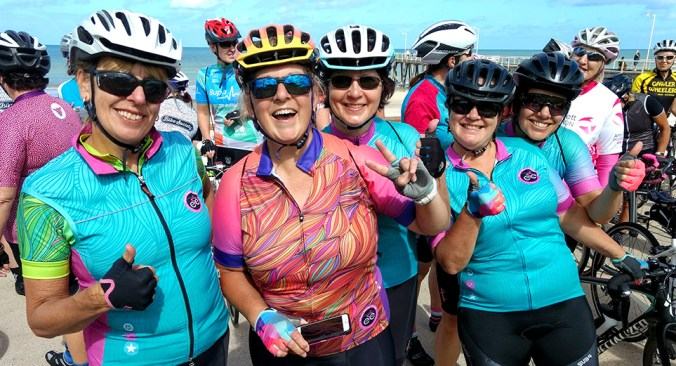 Women in cycling gear posing for the camera