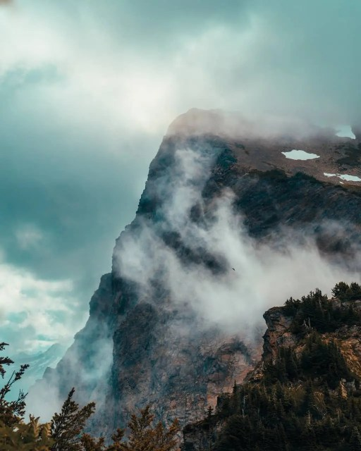 Lady Peak Mount Cheam among clouds with raven soaring