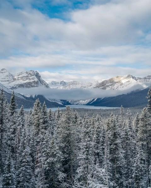 Herbert Lake, Alberta viewpoint with low cloud and alpine winter
