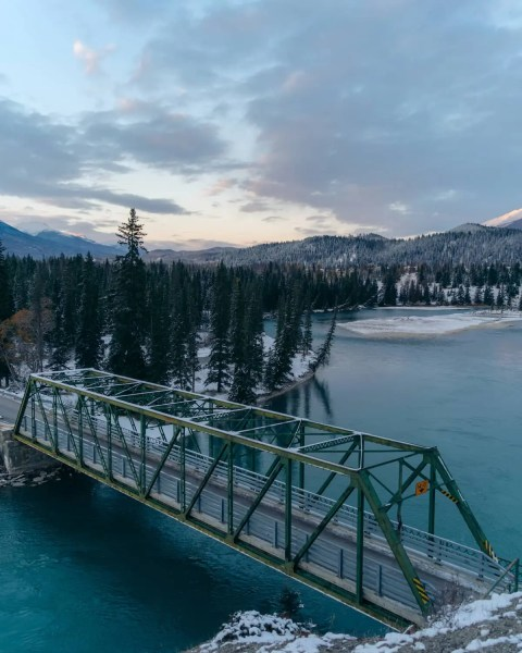 Old Fort Point bridge, Jasper, Alberta, moody sunrise, Athabasca River