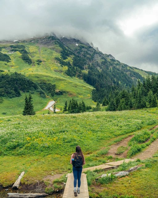 Girl walking of boardwalk on Mount Cheam hike with low clouds