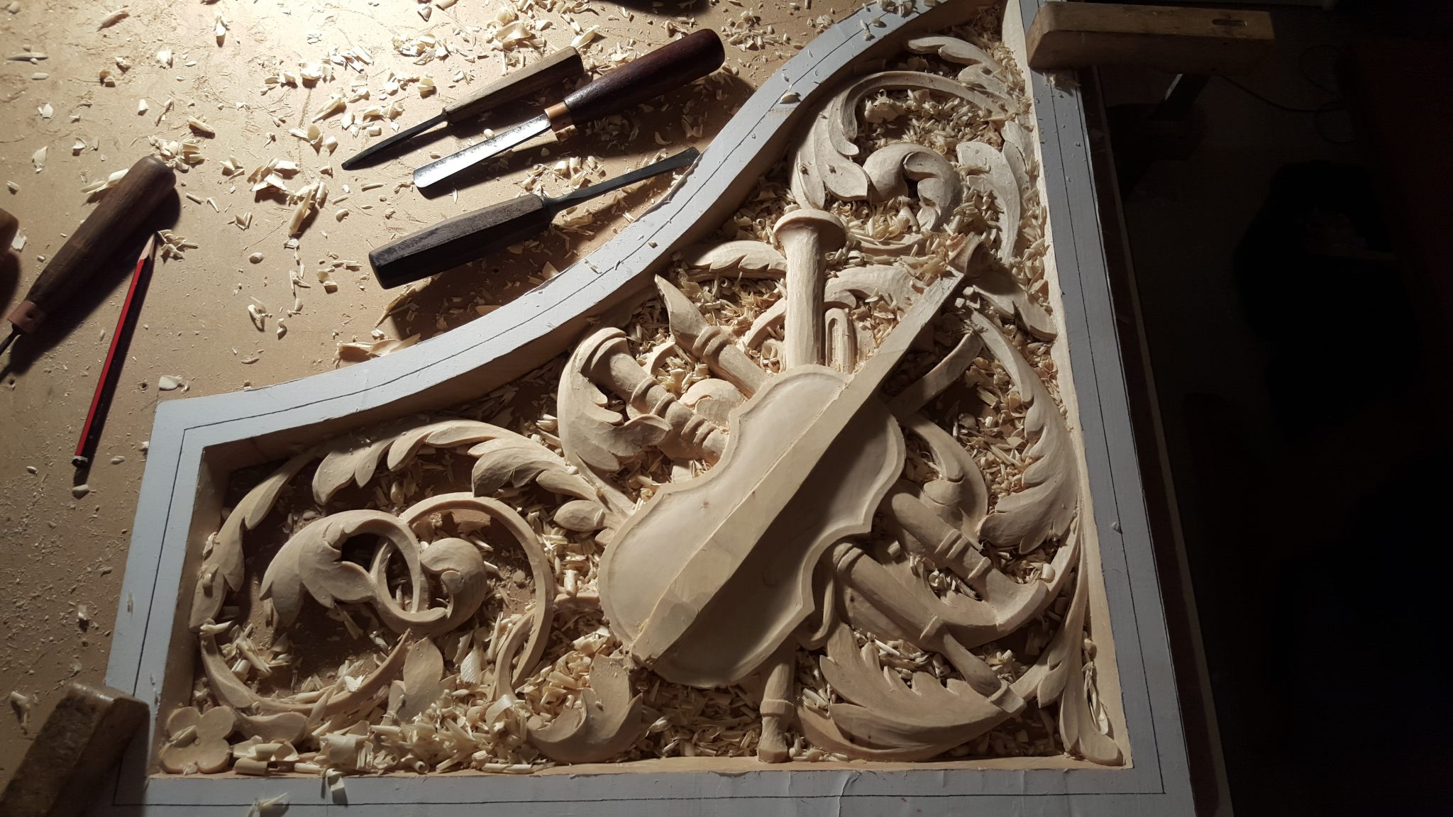 lime wood pipe organ carving with trophy panel violin, shaping stage, by Laurent Robert Woodcarver