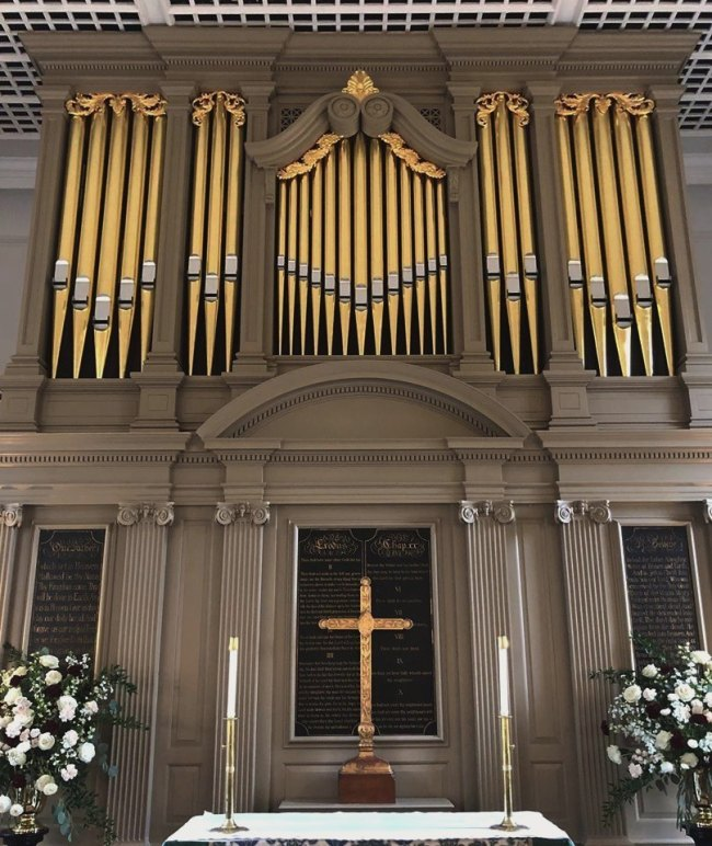 bruton church interior with pipe organ facade including carvings  made by laurent robert