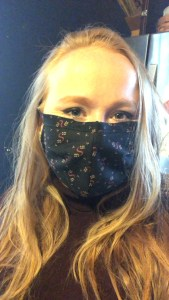 Author wearing mask and smiling (which you cannot see behind the mask)