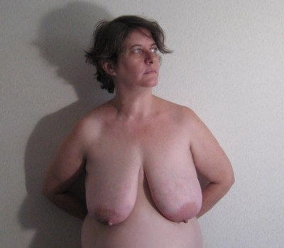 nudefrom waist up against wall