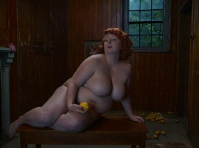 Fat nude holding an apple