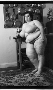 naked fat woman in her kitchen, from Women En Large