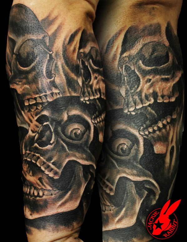 Skulls with Smoke Sleeve Tattoo