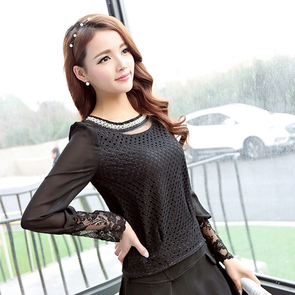 Black jean or trousers and black puff sleeve top