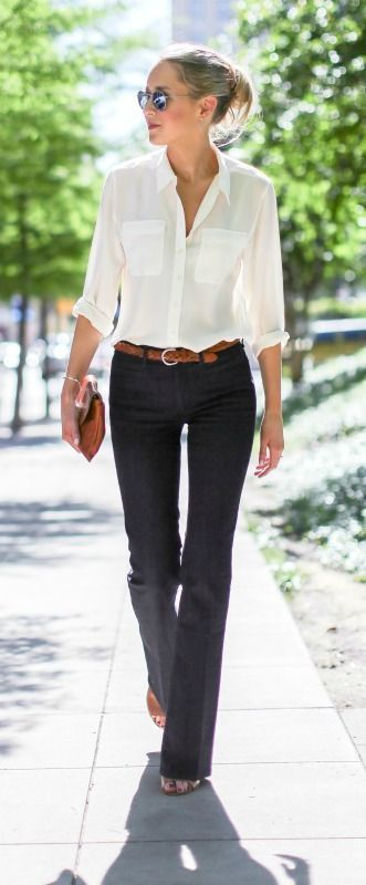 dark wash flare leg bell bottom jeans, silk ivory button front collared blouse, cognac brown braided belt, block heel mules, envelope clutch + messy bun