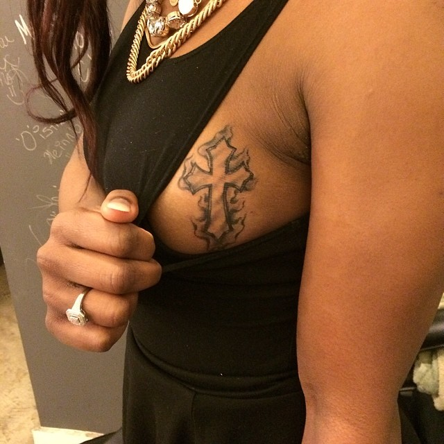 sideboob-tattoos-cross-design
