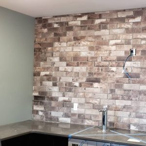 A brickwork tile installation performed by LaValle Flooring in Fargo North Dakota on a bar backsplash.