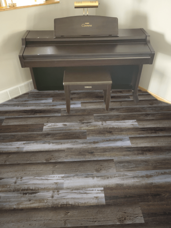 Southwind Colonial Plank Homestead Waterproof Flooring installed around piano