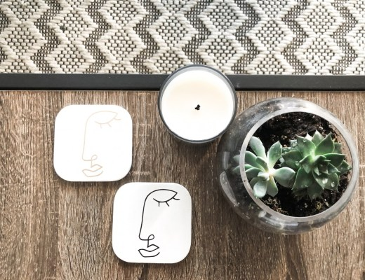 Abstract face coasters on coffee table