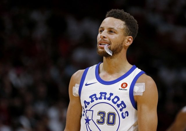 Golden State Warriors guard Stephen Curry looks downcourt during a timeout as the Warriors played the Miami Heat in an NBA basketball game Sunday, Dec. 3, 2017, in Miami. The Warriors won 123-95. (AP Photo/Joe Skipper)