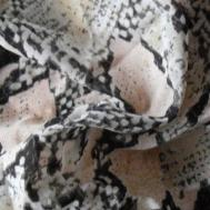This snakeskin printed chiffon fabric would make for a gorgeous blouse, wouldn't it? I can see it already...