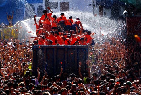 The streets of Bunol, Spain, are awash with red pulp as thousands of people pelt each other with tomatoes in the annual 'Tomatina' tomato fight that has become a major tourist attraction. (Alberto Saiz/Associated Press)