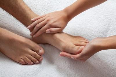 Hands Massaging Feet