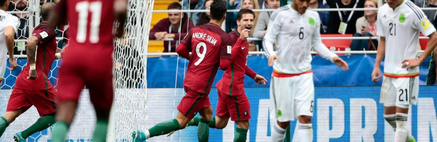 Portugal's Adrien Silva, center, celebrates after scoring his side's second goal during the Confederations Cup, third place soccer match between Portugal and Mexico, at the Moscow Spartak Stadium, Sunday, July 2, 2017. (AP Photo/Denis Tyrin)